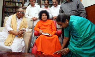Abusing Hindu religions, Gurus and all, he allowed his first wife to portray before Sai Baba!